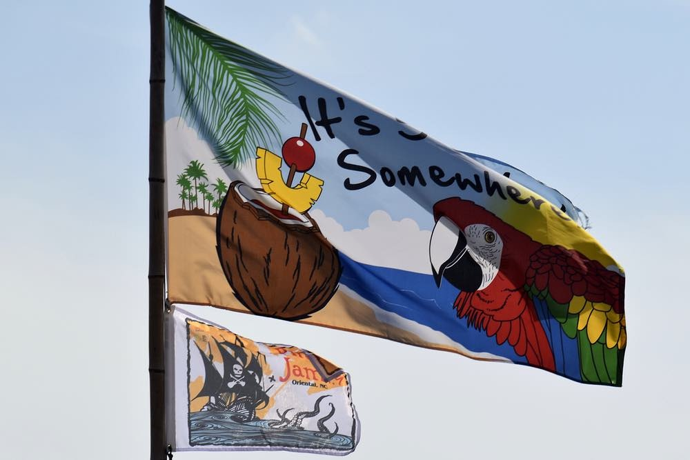 A Pirate Jam burgee complements the floating Tiki Bar's motto. Pirate Jam 2020.